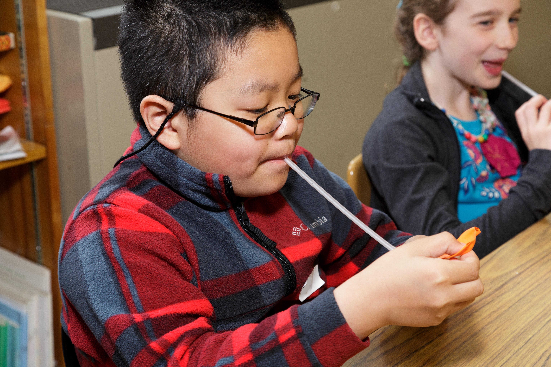 AKA Science - Boy blowing through straw