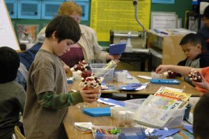 Students in Impact NW's SHINE program building models