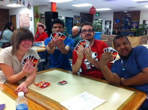 Club Impact participants play UNO