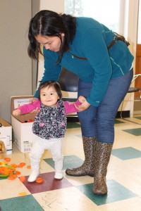 A mother and child play at the Bringing the Museum to the Community event