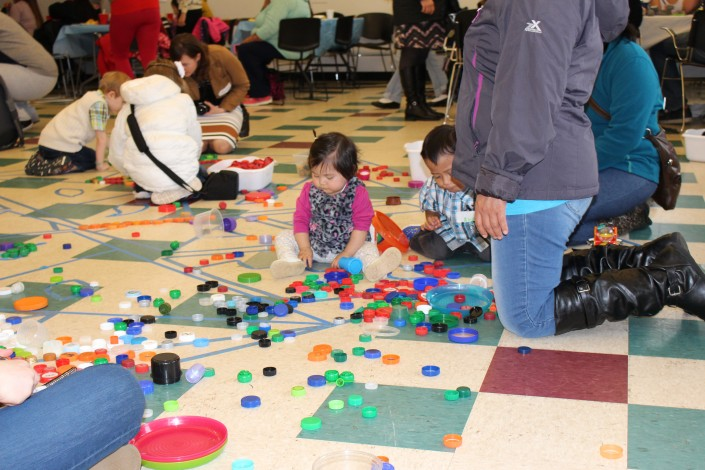 Hundreds of bottle caps were collected through Impact NW. Parents and children worked together to make art at the Bring the Museum to the Community event