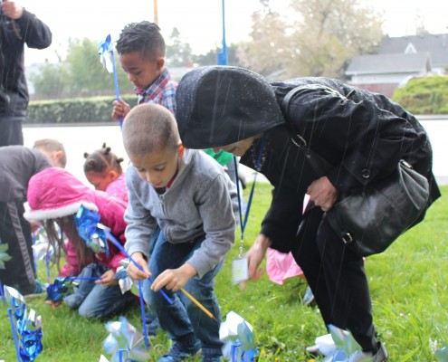 PPS Vestal School Elementary Kindergarten students brave the rain to plant pinwheels in support of Child Abuse Prevention Month.