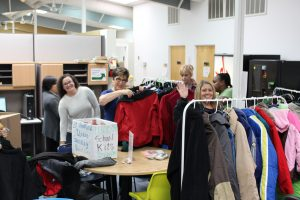 Coat Drive 2016 - Impact staff and clients sorting coats