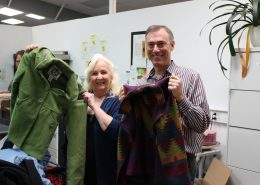 Dianne Denham and Jeff Cogen display donated coats