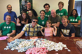 AWS Elemental volunteers and family sorting sugar packets