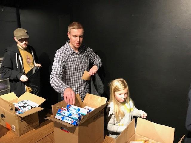 Volunteers building Impact Kits