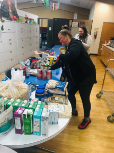 Impact NW Staff Organizing Essential Items